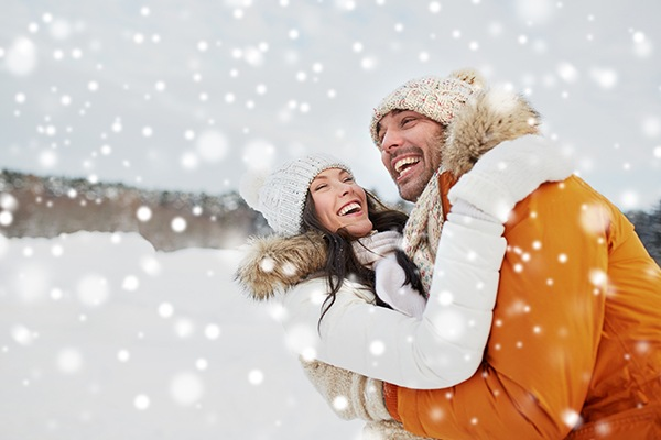 smiling couple in the snow