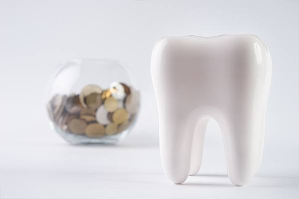 Tooth with coin bank