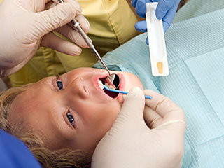 Young child receiving fluoride treatment