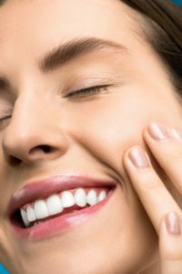 Woman with a beautiful smile from cosmetic dentist in Edison.