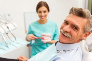 elderly man getting dentures in Edison