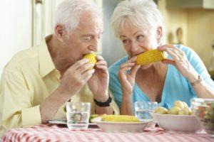 older couple enjoying eating summer foods